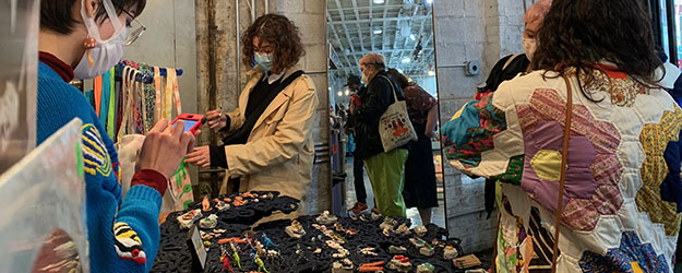 Shoppers and sellers masked up at Artists & Fleas Williamsburg enjoying a day of discovery