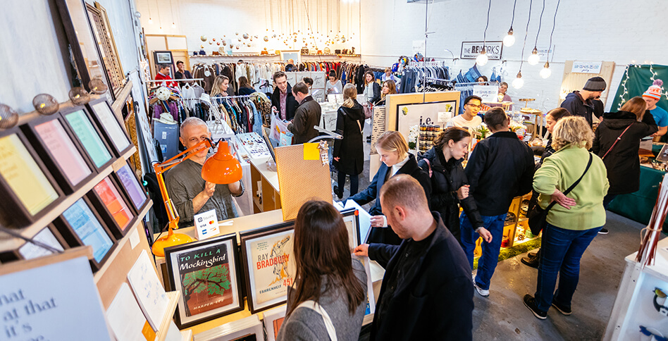 People shopping quotes and prints from Arthurious at Artists & Fleas Williamsburg