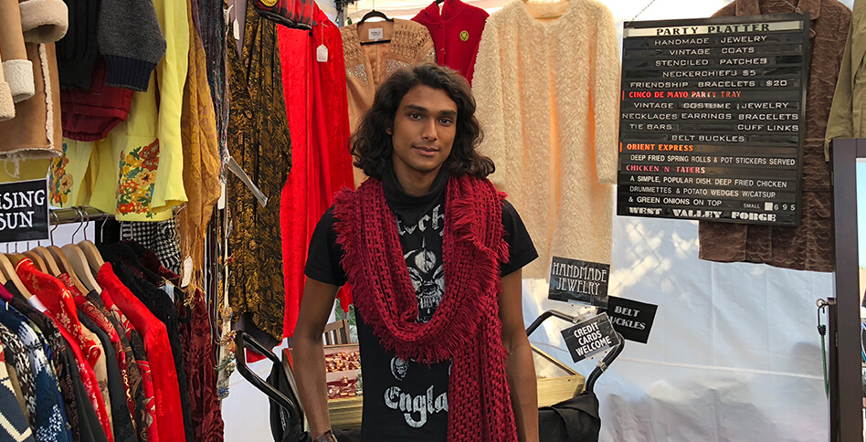 Man in red scarf with vintage clothing at Artists & Fleas Venice