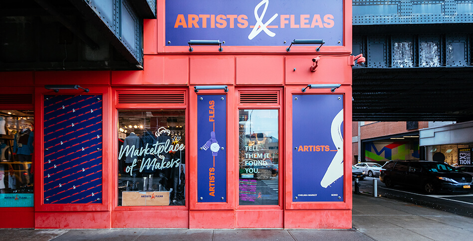 Exterior of Artists & Fleas Chelsea Market with red wall and purple logo